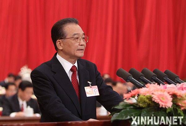 3月5日,第十一届全国人民代表大会第三次会议在北京人民大会堂开幕。国务院总理温家宝作政府工作报告。 新华社记者刘卫兵摄