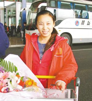 李琰从温哥华回国后,露出了欣慰的笑容。辛朗摄