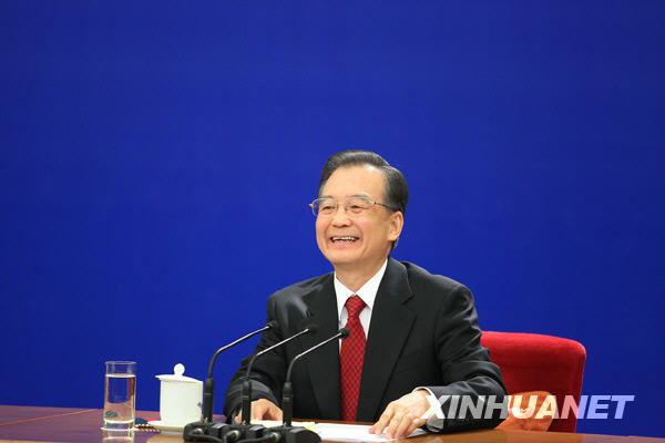 3月14日,国务院总理温家宝在北京人民大会堂与中外记者见面,并回答记者提问。 新华社记者邢广利摄