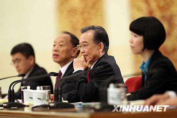 3月14日,国务院总理温家宝在北京人民大会堂与中外记者见面,并回答记者提问。 新华社记者刘卫兵摄