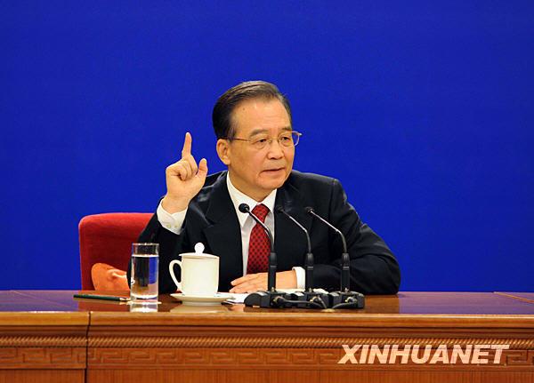 3月14日,国务院总理温家宝在北京人民大会堂与中外记者见面,并回答记者提问。 新华社记者陈树根摄