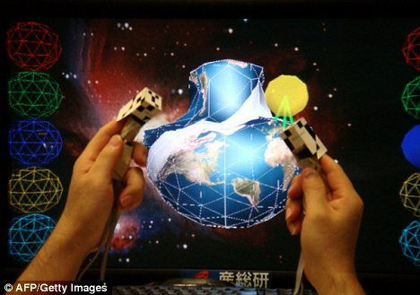 Tiny clips on the two index fingers vibrate to give the sensation of touch when interacting with the virtual environment
