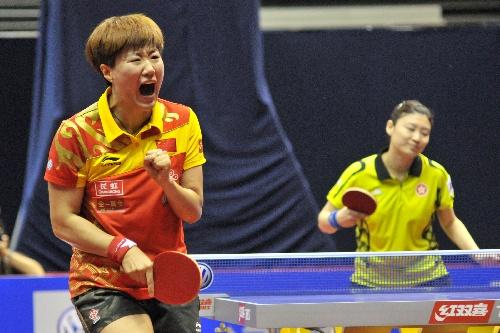 图文:女乒世界杯26日赛况 郭焱握拳怒吼庆祝