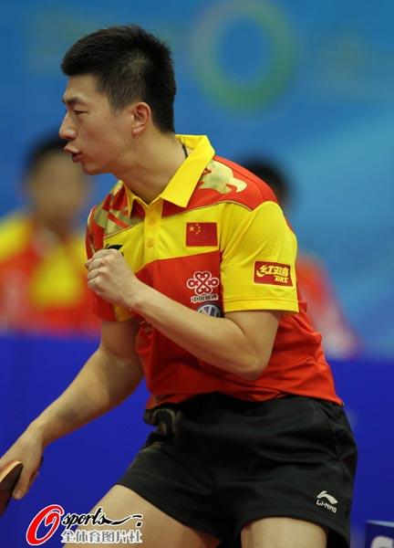 图文:乒乓球世界杯男团登顶 马龙振臂呐喊