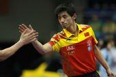 图文:男子乒球世界杯张继科进四强 与对手握手