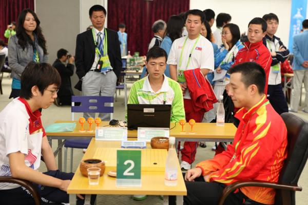 图文:男团中韩焦点战意外收场 古力对阵姜东润