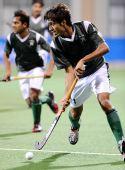 图文:男子曲棍球巴基斯坦夺冠 带球突破特写