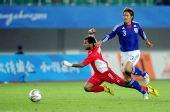 图文:男足决赛日本1-0阿联酋 埃卜里被拉倒