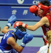 图文:拳击女子57-60KG董程夺冠 重拳击中对手