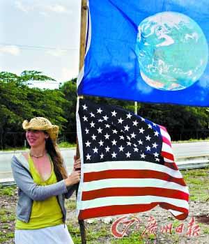 一名来自美国的抗议者要求奥巴马政府为减排作出更大努力。