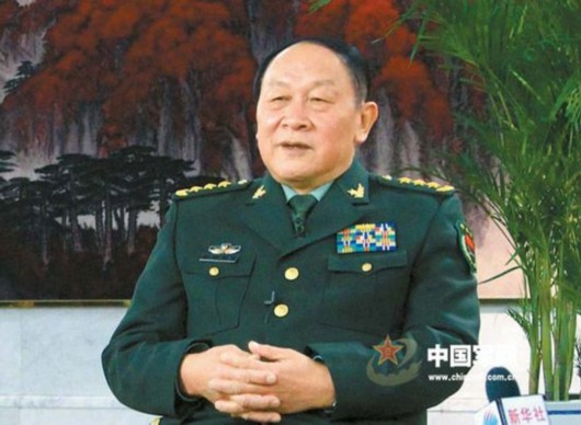 梁光烈:我军信息化条件防卫作战能力明显增强(图)