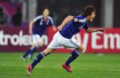 图文:亚洲杯日本夺冠 李忠成在比赛中庆祝进球