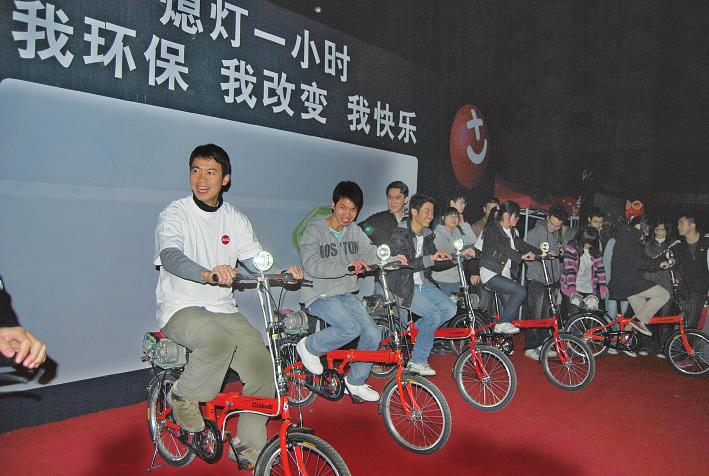 可口可乐环保秀出新意用自行车踩出一片光明(图)图片
