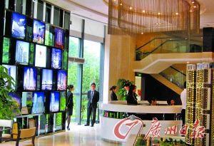五一小长假首日,广州市天河区某楼盘售楼部甚为冷清。记者 莫伟浓 摄