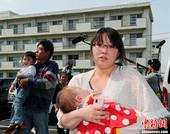 组图:日本开始撤离福岛核电站30公里外居民