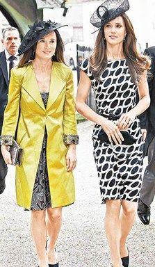 凯特王妃(右)上周末身穿黑白相间洋装与妹妹皮帕·米德尔顿参加婚礼