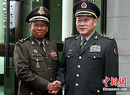 新闻滚动_搜狐资讯    6月22日下午,中国国务委员兼国国防部长梁光烈