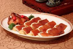 逸东糯米丝苗烤乳猪