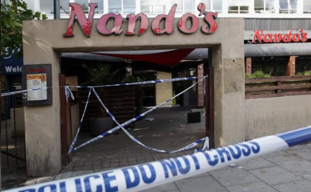 伦敦/骚乱之前,英国伦敦兰贝斯区布里克斯顿的一家饭店。