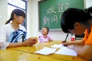 北京二千打工子弟到公办校报到 尚有千人未登记