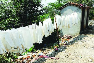 纺织品洗涤企业用脏水兑工业洗涤剂洗出白餐巾