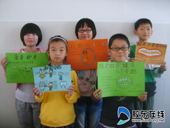 小学生制作的爱牙护牙手抄报 -小学生开展爱牙行动 制作手抄报 搜狐滚