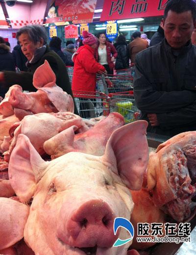 年关到猪头肉热销,一斤6.9元