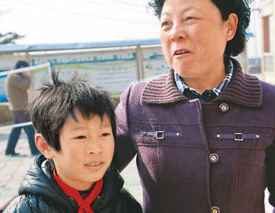 定远县教育局副局长唐仁凤也是王浩的爱心妈妈。