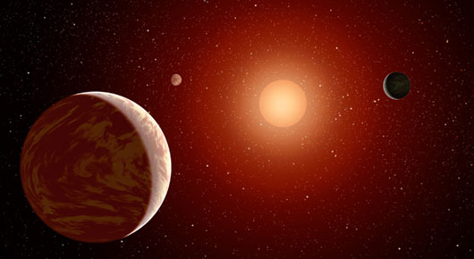 艺术家描绘的一颗年轻红矮星被三颗行星所环绕,这样的恒星比太阳更加昏暗,但最新研究表明红矮星更适宜生命体的存在