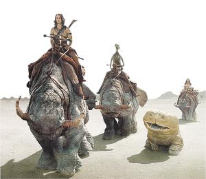 泰勒・克奇扮演的约翰・卡特(左)从地球上的洞窟穿越到了火星。
