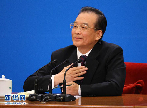 3月14日,国务院总理温家宝在北京人民大会堂与中外记者见面,并回答记者提问。 新华社记者 陈建力 摄
