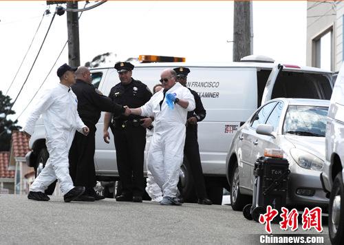 图为案发当天旧金山法医检验办公室和警察现场取证。中新社发 陈钢 摄