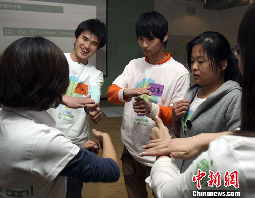 中国聋哑和日本_北京聋哑大学生欲圆\