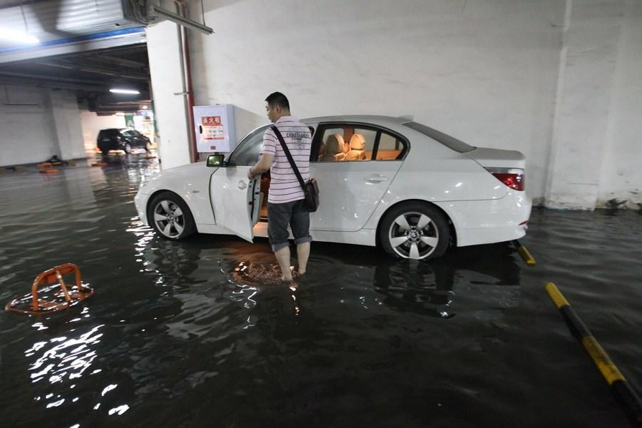 5月21日,重庆遭遇暴雨袭击,导致主城区多处积水严重。图为巴南区跳石镇发生水灾