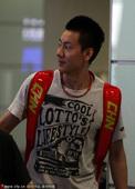 图文:汤尤杯国羽凯旋抵京 陈金帅气依旧