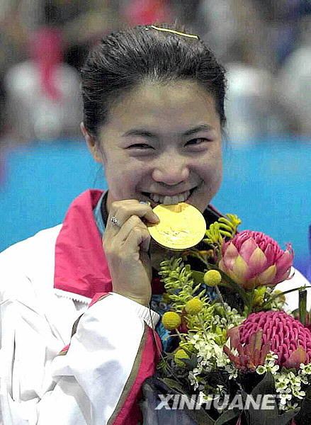 王楠金牌映笑脸