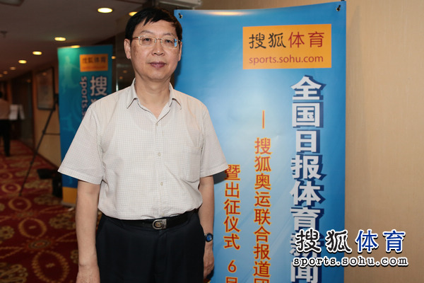 报道团总指挥、人民日报社体育部主任刘小明