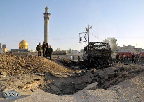 叙利亚首都大马士革郊区14日发生自杀式汽车炸弹爆炸,图为叙士兵查看爆炸现场