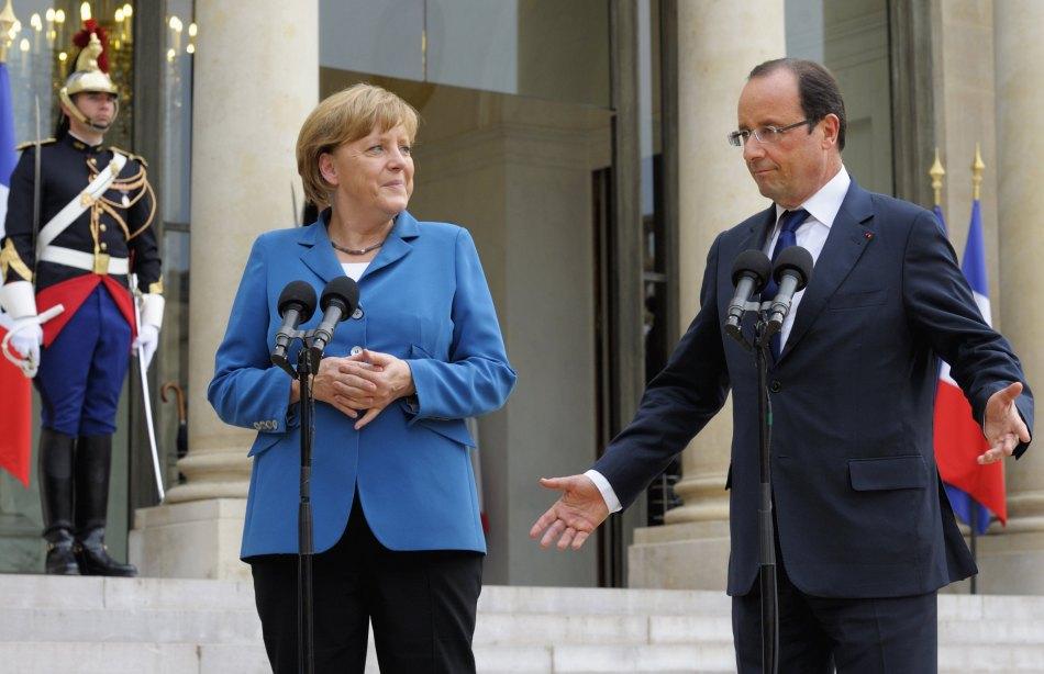 德国总理默克尔与法国总统奥朗德会面表情搞怪