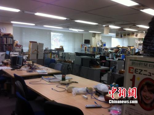 日本 中国 官志雄/朝日新闻社办公场景之一。官志雄摄