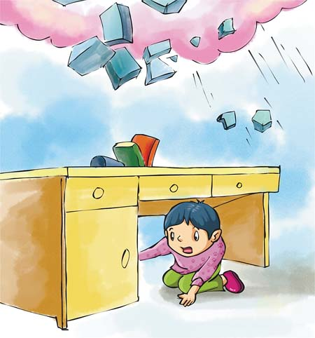 地震发生时,可选择在室内的桌子下面躲避,并尽量蜷曲身体.图片