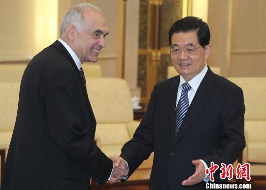 月20日,中国国家主席胡锦涛在北京人民大会堂会见