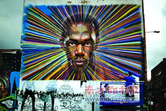 """澳大利亚艺术家在伦敦街头涂鸦""""博尔特""""。IC图片"""
