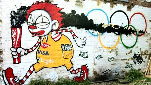 这幅涂鸦表达的是,不少商家大发奥运财,宣传一些与奥运精神相悖的产品