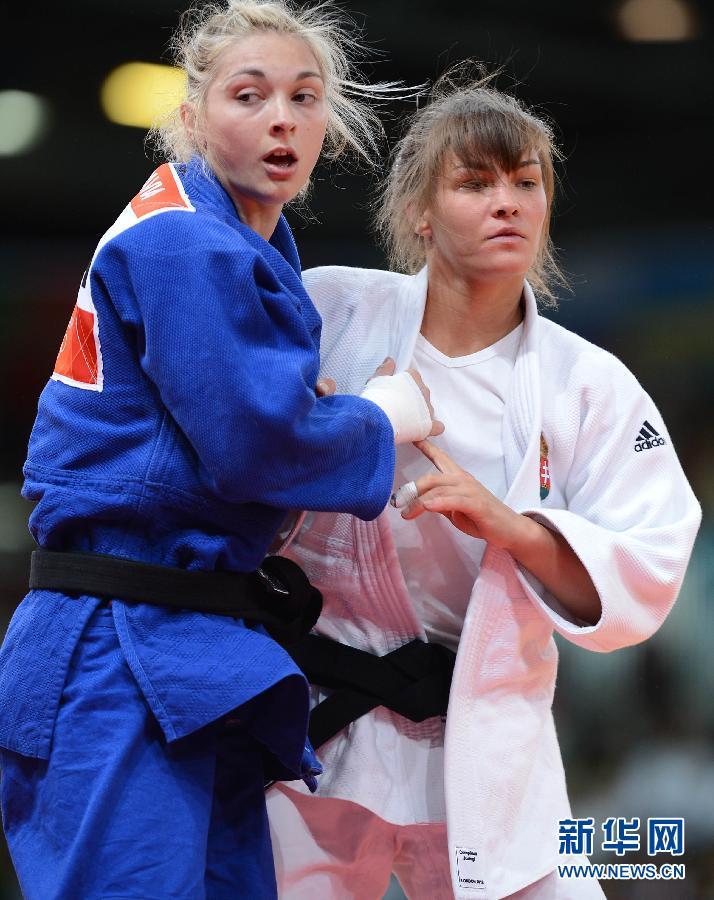 2012年7月30日,在伦敦奥运会柔道女子57公斤级铜牌争夺战中,法国选手帕维亚战胜匈牙利选手卡拉卡什,获得季军。图为,法国选手帕维亚在赛后庆祝。新华社记者 吴晓凌