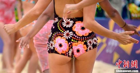 当地时间8月1日,2012伦敦奥运会沙滩排球比赛现场,沙排宝贝性感十足。图片来源:东方IC 版权作品 请勿转载