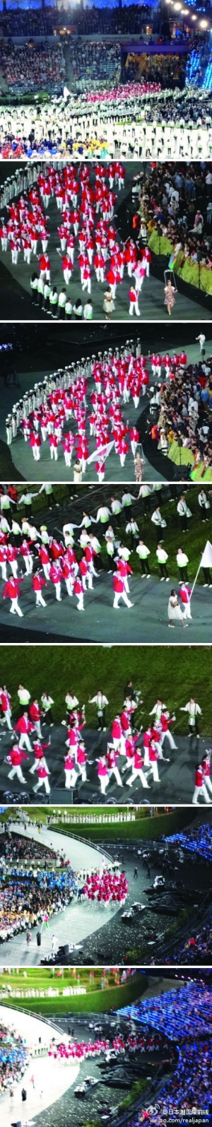 从组图可以看出,日本队在引导员的带领下,绕出了体育场。