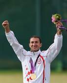 奥运图:男子飞碟双向小将加时险胜 十分开心