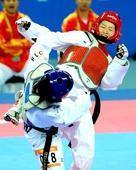 奥运图:跆拳道吴静钰卫冕冠军 第16届亚运会时