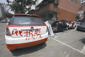 深圳汽修厂改装报废车销往内地 老板称关系很